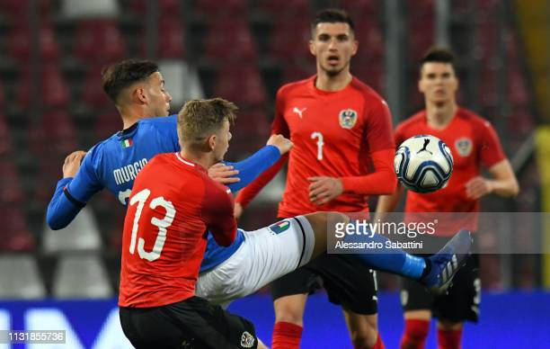 Alessandro Murgia of Italy U21 competes for the ball with Maximilian Ullmann of Austria U21 during the International Friendly match between Italy U21...
