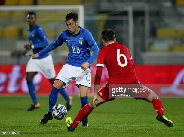 Alessandro Murgia of Italy U21competes for the ball with Oleg Lanin of Russia U21 during the international friendly match between Italy U21 and...