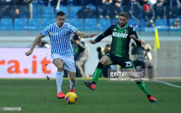 Alessandro Murgia of SPAL competes the ball with Domenico Berardi of US Sassuolo during the Serie A match between SPAL and US Sassuolo at Stadio...