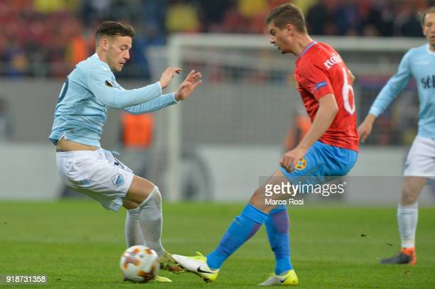 Alessandro Murgia of SS Lazio compete for the ball with Dragos Nedelcu of Steaua Bucharest during UEFA Europa League Round of 32 match between Steaua...