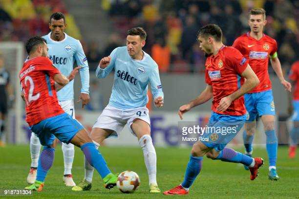 Alessandro Murgia of SS Lazio compete for the ball with Junior Morais of Steaua Bucharest during UEFA Europa League Round of 32 match between Steaua...