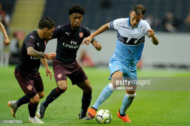 Alessandro Murgia of SS Lazio compete for the ball with Lucas Torreira of Arsenal during the the Preseason friendly between SS Lazio and Arsenal at...