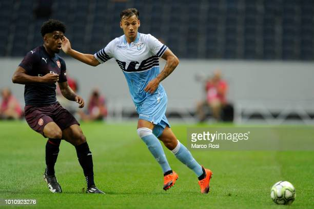 Alessandro Murgia of SS Lazio compete for the ball with Reiss Nelson of Arsenal during the the Preseason friendly between SS Lazio and Arsenal at...