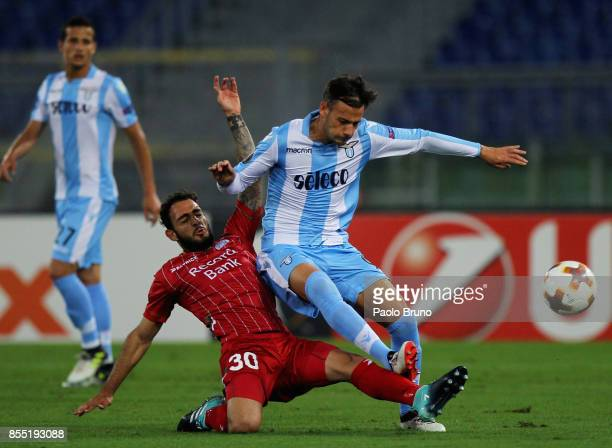 Alessandro Murgia of SS Lazio competes for the ball with Grigoris Kastanos of SV Zulte Waregem during the UEFA Europa League group K match between SS...