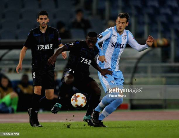 Alessandro Murgia of SS Lazio competes for the ball with Nampalys Mendy of OGC Nice during the UEFA Europa League group K match between SS Lazio and...
