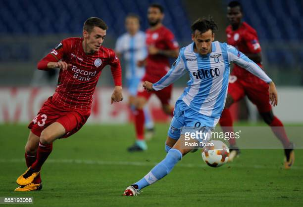 Alessandro Murgia of SS Lazio competes for the ball with Sander Coopman of SV Zulte Waregem during the UEFA Europa League group K match between SS...