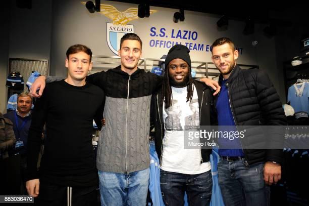 Alessandro Murgia Thomas Strakoscha Jordan Lukaku and Stefan De Vrij of SS Lazio players visit the new Macron Store on November 30 2017 in Rome Italy