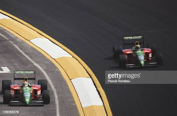 Alessandro Nannini drives the Benetton Formula Benetton B190 Ford HB 35 V8 through the Peralta curve as team mate Nelson Piquet drives into the pirts...