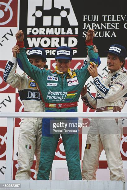 Alessandro Nannini of Italy and driver of the Benetton Formula Ltd Benetton B189 Ford Cosworth V8 celebrates with second placed Riccardo Patrese and...