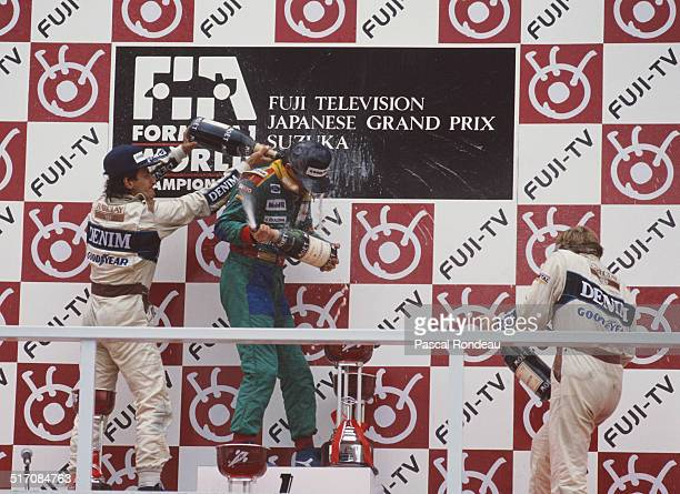 Alessandro Nannini of Italy and driver of the Benetton Formula Ltd Benetton B188 Ford V8 celebrates with second placed Riccardo Patrese and third...