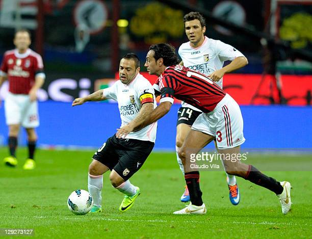 Alessandro Nesta of AC Milan and Fabrizio Miccoli of US Citta di Palermo compete for the ball during the Serie A match between AC Milan and US Citta...