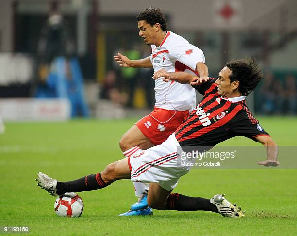 Alessandro Nesta of AC Milan and Paulo Vitor de Souza Barreto of AS Bari compete for the ball during the Serie A match between AC Milan and AS Bari...