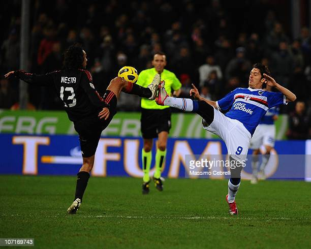 Alessandro Nesta of AC Milan battles for the ball against Nicola Pozzi of UC Sampdoria during the Serie A match between UC Sampdoria and AC Milan at...