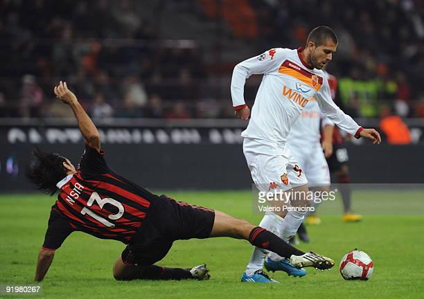 Alessandro Nesta of AC Milan battles for the ball with Jeremy Mènez of AS Roma during the Serie A match between AC Milan and AS Roma at Stadio...