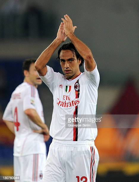 Alessandro Nesta of AC Milan celebrates after scoring his team's second during the Serie A match between AS Roma and AC Milan at Stadio Olimpico on...
