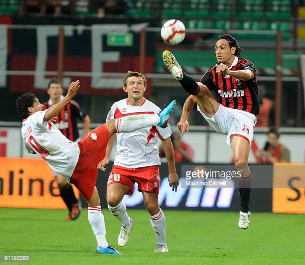 Alessandro Nesta of AC Milan, Paulo Vitor de Souza Barreto and Vitali Kutuzov of AS Bari compete for the ball during the Serie A match between AC...