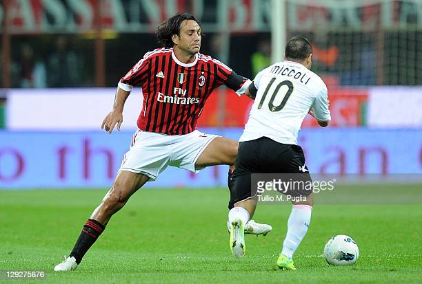 Alessandro Nesta of Milan and Fabrizio Miccoli of Palermo compete for the ball during the Serie A match between AC Milan and US Citta di Palermo at...