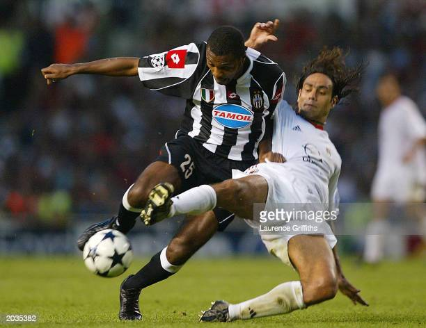 Alessandro Nesta of Milan tries to tackle Marcelo Zalayeta of Juventus FC during the UEFA Champions League Final match between Juventus FC and AC...