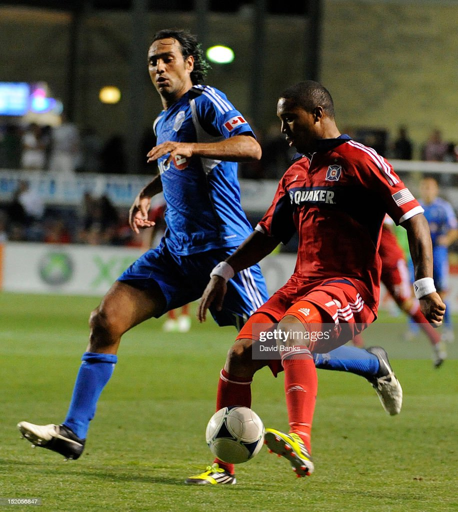 Alessandro Nesta #14 of Montreal Impact and Sherjill MacDonald #7, right, of the Chicago Fire in an MLS match on September 15, 2012 at Toyota Park in Bridgeview, Illinois. The Chicago Fire defeated the Montreal Impact 3-1.