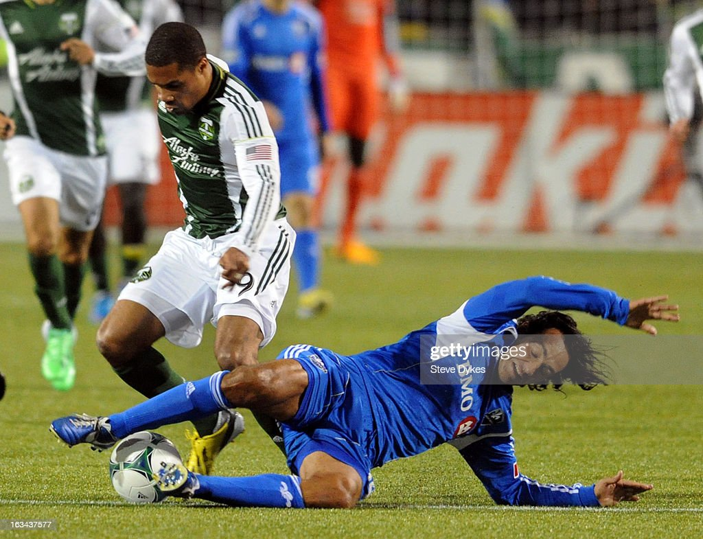 Alessandro Nesta #14 of Montreal Impact slides in to try and take the ball away from Ryan Johnson #9 of Portland Timbers during the second half of the game at Jeld-Wen Field on March 09, 2013 in Portland, Oregon. Montreal woin ther game 2-1.