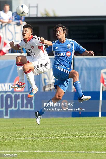 Alessandro Nesta of the Montreal Impact and Conor Shanosky of the DC United heads the ball during the MLS match at Saputo Stadium on August 25 2012...