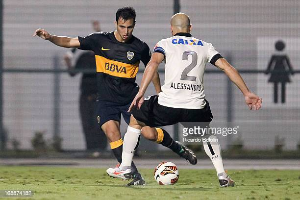 Alessandro of Corinthians fights for the ball with Walter Erviti of Boca Juniors during a match between Corinthians and Boca Juniors as part of the...