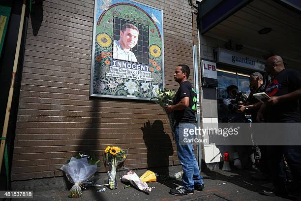 Alessandro Pereira the cousin of Brazilian national Jean Charles de Menezes lays flowers during a memorial to mark the 10th anniversary of his death...