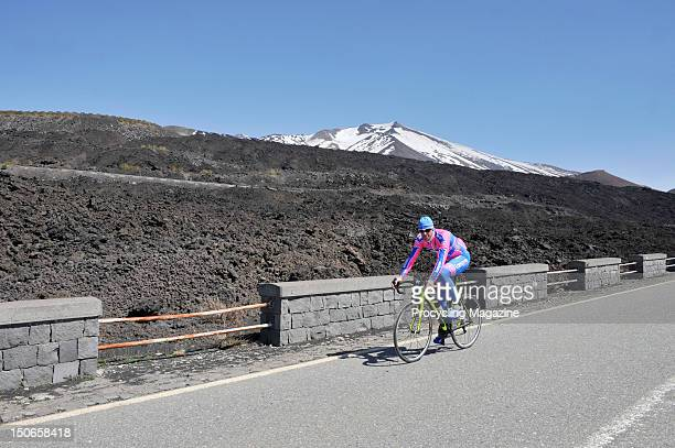Alessandro Petacchi from Team Lampre, riding past Mount Etna, Italy, April 13, 2011.