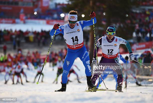 Alessandro Pittin of Italy competes with Hideaki Nagai of Japan during the Men's Nordic Combined 10km Cross-Country during the FIS Nordic World Ski...