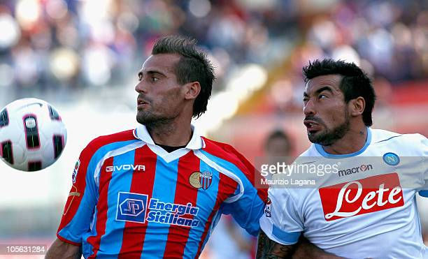 Alessandro Potenza of Catania Calcio battles for the ball with Ezechiel Lavezzi of SSC Napoli during the Serie A match between Catania Calcio and SSC...