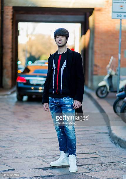 Alessandro Pozzetti is wearing a denim jeans sneaker boots knit during Milan Men's Fashion Week Fall/Winter 2017/18 at Missoni on January 15 2017 in...