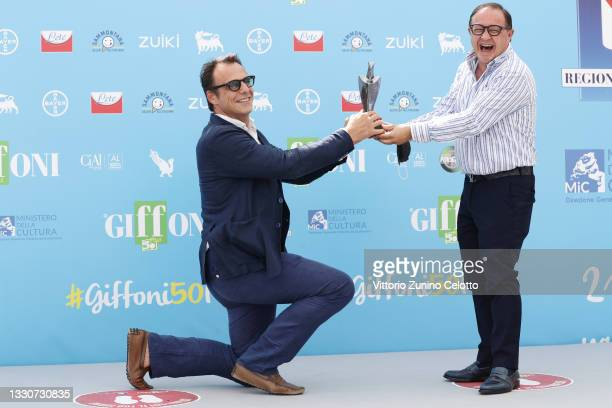 Alessandro Preziosi and and President of the Giffoni Film Festival Pietro Rinaldi pose with the Giffoni Award during the photocall at the Giffoni...