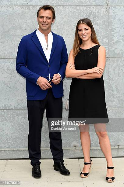 Alessandro Preziosi and Giulia Innocenzi attend the Emporio Armani show during Milan Menswear Fashion Week Spring Summer 2015 on June 23 2014 in...