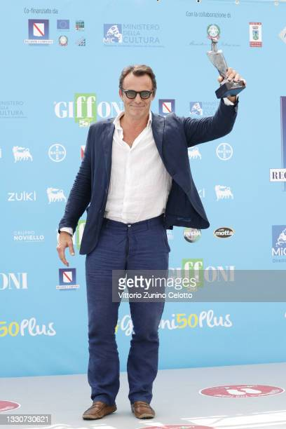 Alessandro Preziosi poses with the Giffoni Award during the photocall at the Giffoni Film Festival 2021 on July 26, 2021 in Giffoni Valle Piana,...