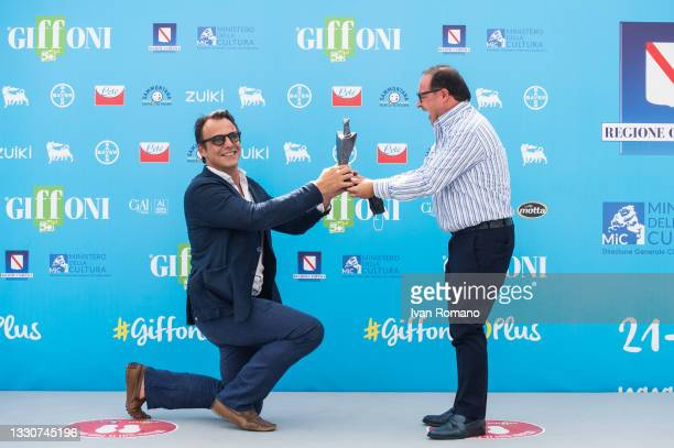 Alessandro Preziosi with Giffoni Award 2021 and Pietro Rinaldi attends the photocall at the Giffoni Film Festival 2021 on July 26, 2021 in Giffoni...