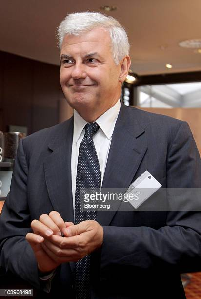 Alessandro Profumo chief executive officer of UniCredit SpA walks to a meeting at the the Banks in Crisis conference in Frankfurt Germany on...