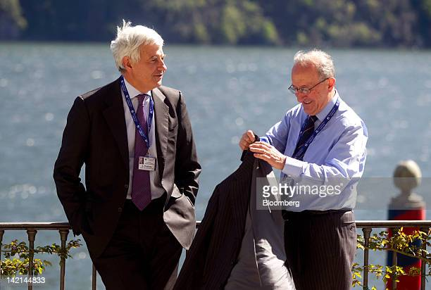 Alessandro Profumo, former chief executive officer of UniCredit SpA, left, speaks with Angelo Tantazzi, former chairman of the Borsa Italiana,...