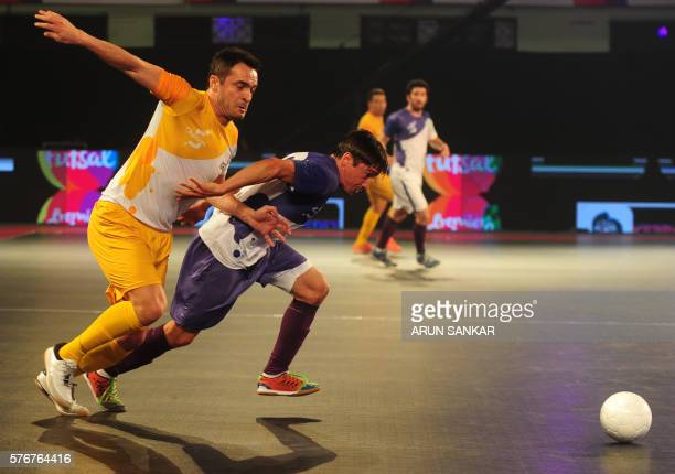 Alessandro Rosa Viera also known Falcao from the Chennai 5's plays against the Kochi 5's Chaguinha during their Premier Futsal Football League match...