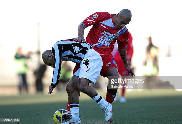 Alessandro Rosina of AC Siena fights for the ball with Sergio Bernardo Almiron of Calcio Catania during the Serie A match between AC Siena and Calcio...