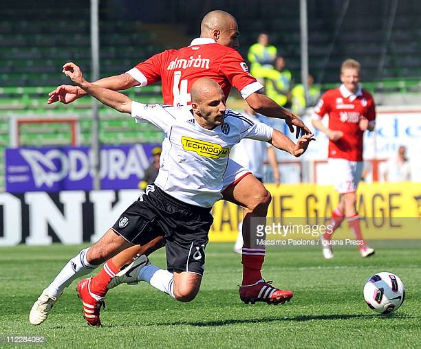 Alessandro Rosina of Cesena competes with Sergio Bernardo Almiron of Bari during the Serie A match between AC Cesena and AS Bari at Dino Manuzzi...