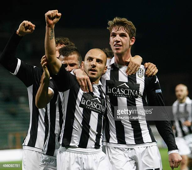 Alessandro Rosina of Siena celebrates with teammates after scoring the opening goal during the Serie B match between Reggina Calcio and AC Siena at...