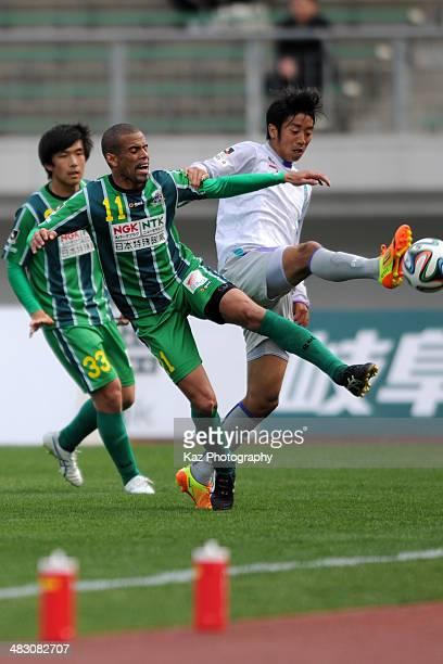 Alessandro Santos of FC Gifu and Shoki Hirai of Avispa Fukuoka compete for the ball during the J League second division match between FC Gifu and...