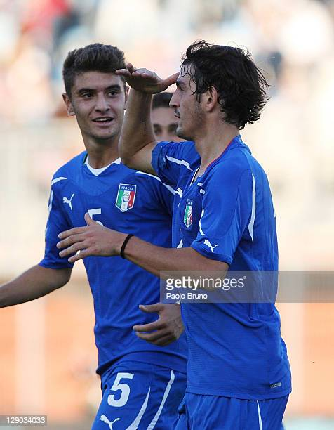 Alessandro Saponara of Italy celebrates with teammate Luca Antei after scoring the opening goal of the UEFA European Under21 Championship qualifying...