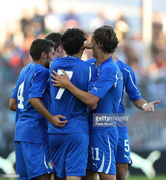 Alessandro Saponara of Italy celebrates with teammates after scoring the opening goal of the UEFA European Under21 Championship qualifying match...
