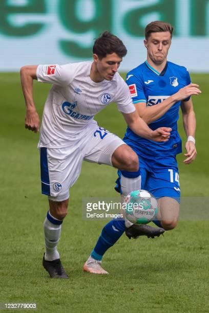 Alessandro Schoepf of FC Schalke 04 and Christoph Baumgartner of TSG 1899 Hoffenheim battle for the ball during the Bundesliga match between TSG...