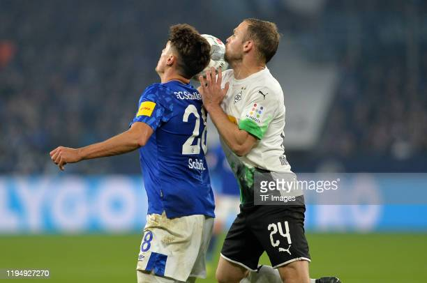 Alessandro Schoepf of FC Schalke 04 and Tony Jantschke of Borussia Moenchenglad bachbattle for the ball during the Bundesliga match between FC...