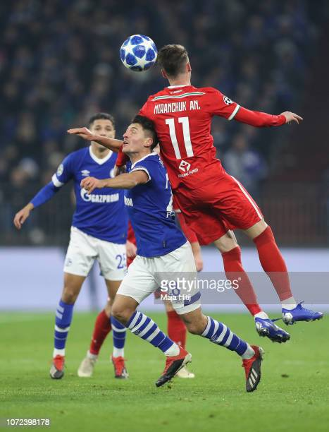 Alessandro Schoepf of FC Schalke 04 jumps for the ball with Anton Miranchuk of Lokomotiv Moscow during the UEFA Champions League Group D match...