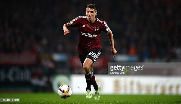 Alessandro Schoepf of Nuernberg runs with the ball during the DFB Cup match at GrundigStadion on October 27 2015 in Nuremberg Germany