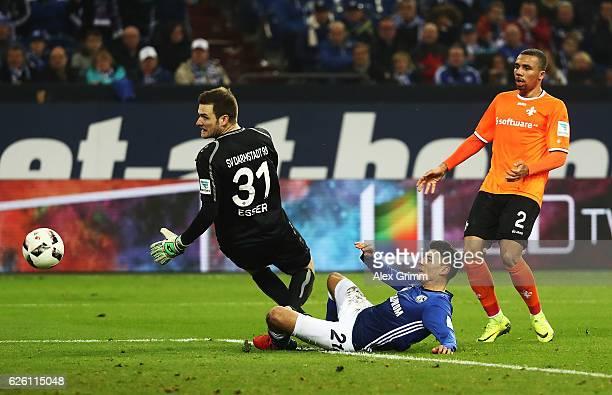 Alessandro Schoepf of Schalke 04 scores a goal past Michael Esser of SV Darmstadt 98 during the Bundesliga match between FC Schalke 04 and SV...