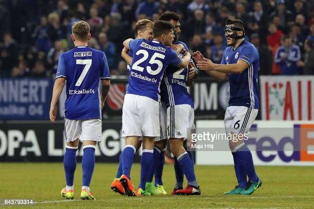 Alessandro Schoepf of Schalke celebrates his team's first goal with team mates during the UEFA Europa League Round of 32 second leg match between FC...